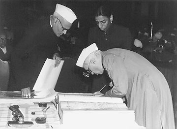 Nehru signing Indian constitution
